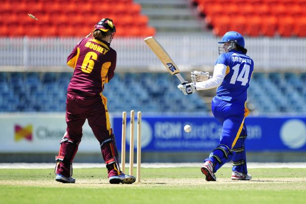 ACT Meteors batter Nicola Brown looks back as she gets bowled.
