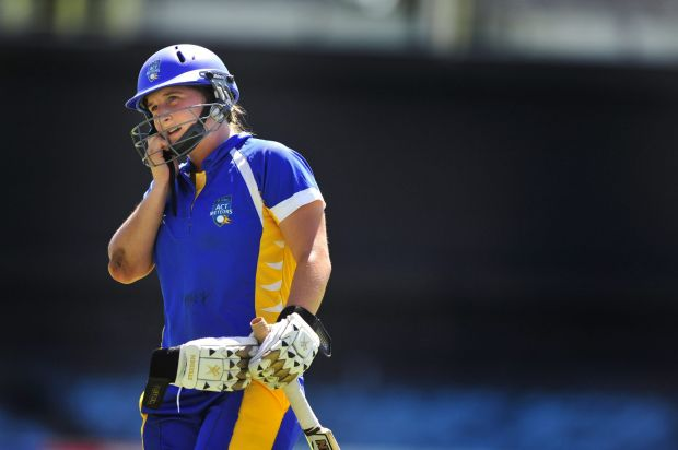 ACT Meteors batter Jenny Taffs leaves the field after being caught out.