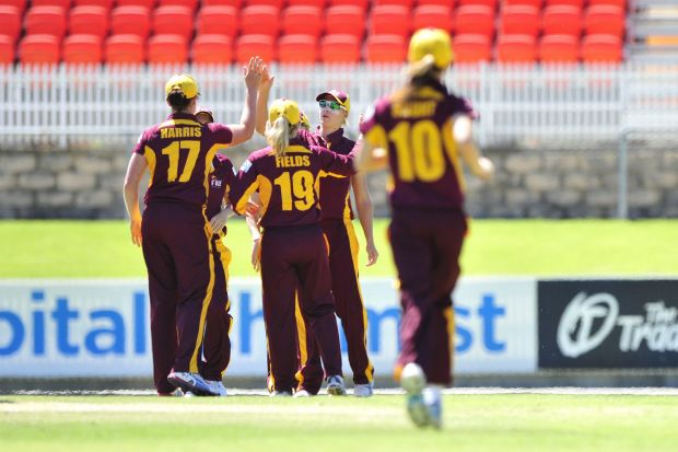 Queensland Fire players celebrate after catching out ACT Meteors batter Jenny Taffs