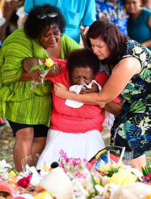 Loved ones mourn the loss of eight children in Cairns.