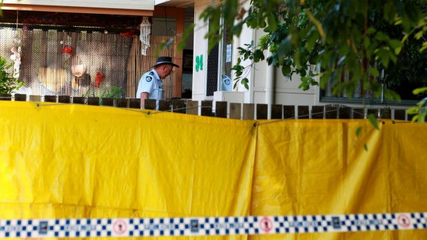 Police at the Cairns home where eight children were killed.