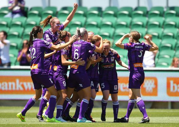 Collette McCallum of the Glory is congratulated by team mates after scoring a goal.