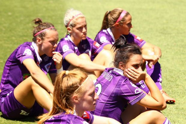 Elisa D'Ovidio of the Glory looks on with team mates after being defeated by Canberra United.