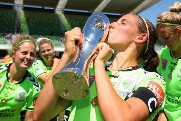Nicole Begg of Canberra kisses the trophy after winning the W-League Grand Final.