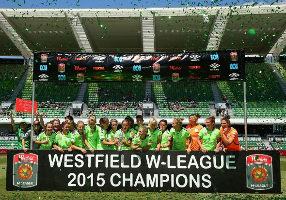 Canberra players and coaching support staff celebrate winning the W-League Grand Final.