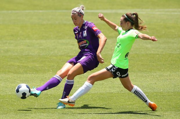 lanna Kennedy of the Glory passes the ball against Grace Maher of Canberra.