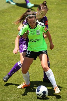 Grace Maher of Canberra controls the ball against Sarah Carroll of the Glory.