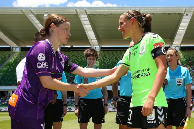 Collette McCallum of the Glory and Nicole Begg of Canberra shake hands after the coin toss during the W-League Grand ...