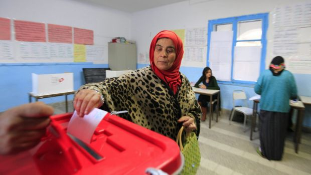 A Tunisian woman casts her ballot in the capital Tunis on Sunday.