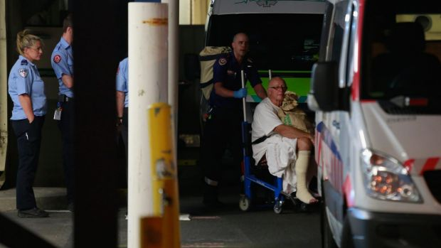 Patients being moved from the Epworth Hospital in Victoria Street after severe flooding.
