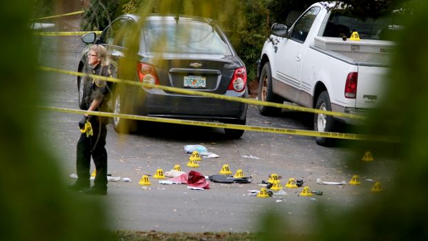 A forensic science investigator at the scene where  police officer Charles Kondek was shot.