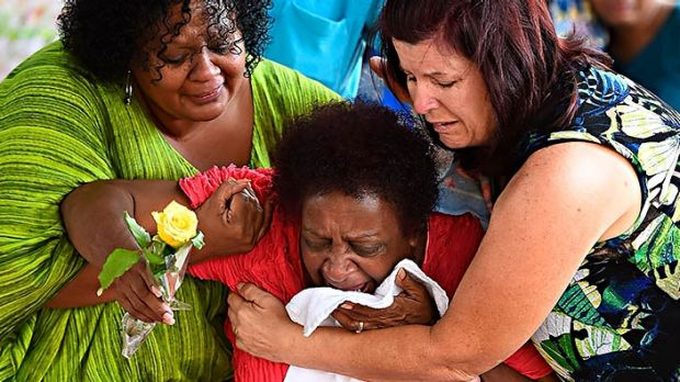 Family pictured in the aftermath of the death of eight children in Cairns in 2014.