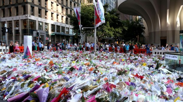 People line up to leave flowers at Martin Place.