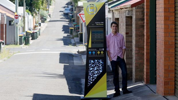 Stress buster: Ted Hodge with his high-tech bus stop outside the garage of his family home. The project delivered him ...