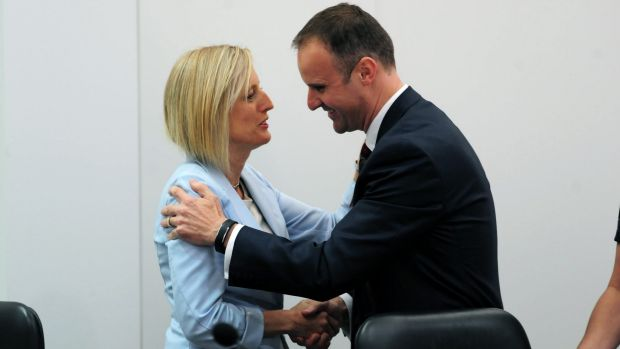 ACT Chief Minister Andrew Barr is congratulated by his predecessor Katy Gallagher.