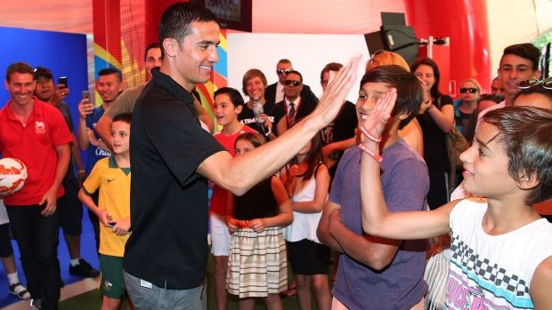 Socceroos star Tim Cahill interacts with fans during the launch of the Asian Cup football fan park at Customs House in ...