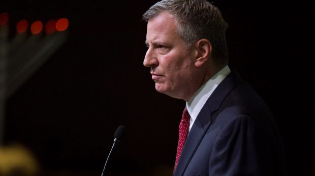 New York City Mayor Bill de Blasio has called for a suspension of protests.