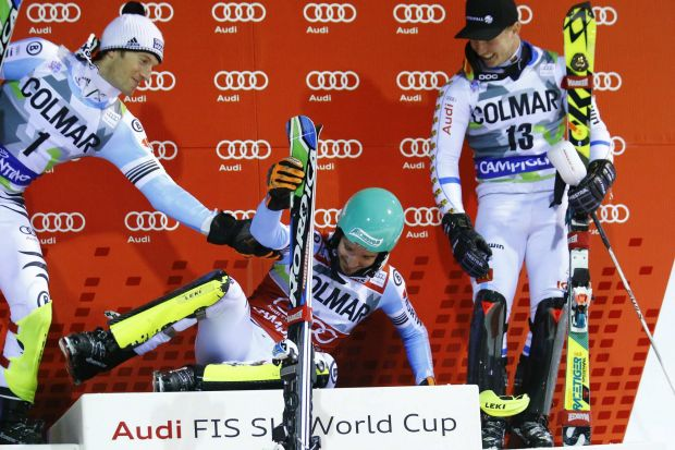 Oops: Felix Neureuther of Germany slips on the podium next to second-placed compatriot Fritz Dopfer and third-placed ...