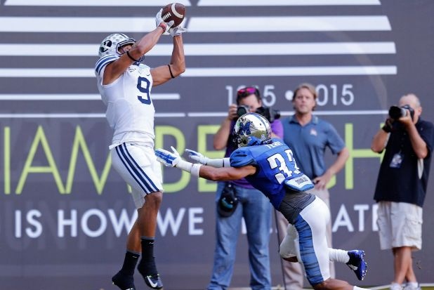 What a catch: Jordan Leslie, of the Brigham Young Cougars, catches a touchdown pass over Frank Wims of the Memphis Tigers.