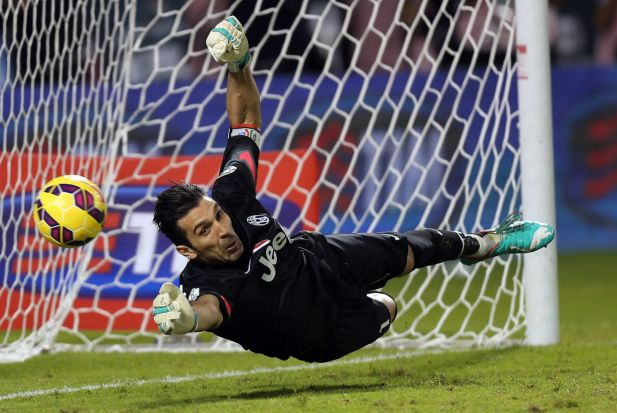 Diving: Juventus FC's Italian goalkeeper Gianluigi Buffon tries to save a penalty during the Italian Super Cup against ...