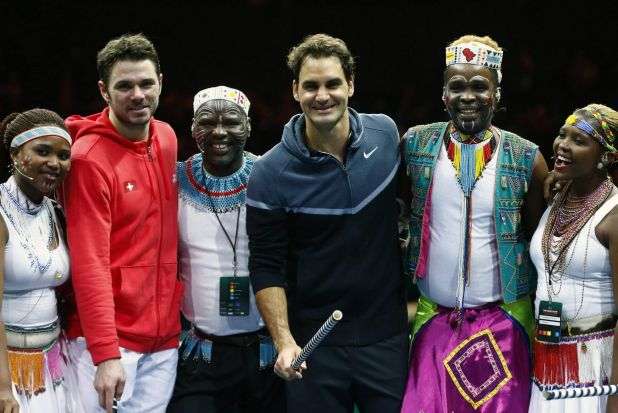 """Helping out: Switzerland's Roger Federer poses with compatriot Stanislas Wawrinka and artists after """"The match for ..."""