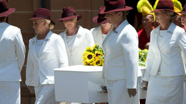 Sunflowers were laid on the coffin of Tori Johnson.