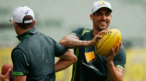 Peter Siddle and Mitchell Johnson enjoy an Australian training session at the MCG on Tuesday.