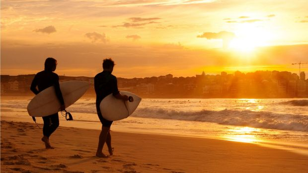 Summer extremes: Surfers at Bondi Beach.