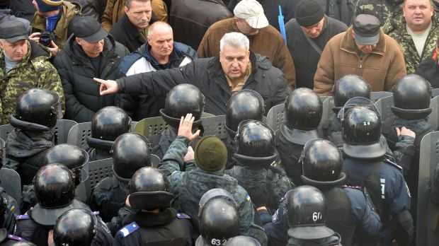 A protester argues with police in front of Ukrainian Parliament.