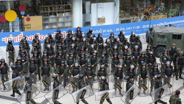 Soldiers prevent protests against military rule in central Bangkok in June, 2014.