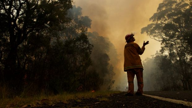 A firefighter feels for rain with the chance of a thunderstorm on Saturday. File image.