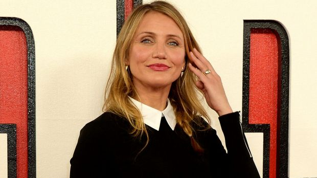 Cameron Diaz, at the <i>Annie</i> premiere, reportedly showing off her engagement bling from rumoured fiance Benji Singer.