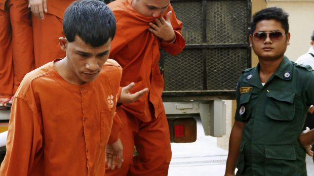 Chea Phin, left, confessed to the murders of Dutch national Daphna Beerdsen and her daughter in their Phnom Penh home.