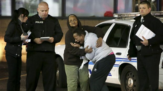 Distraught: Toni Martin at the scene where she says her son Antonio was fatally shot.