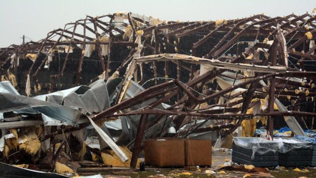 A building is severely damaged on US 98 East near Columbia, Mississippi.