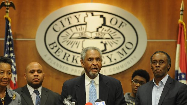 'You could not even compare this with Ferguson' ... Mayor Theodore Hoskins, centre, addresses the media over the latest ...