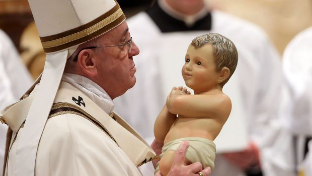 Pope Frances celebrates Christmas Eve mass at St Peter's in the Vatican.