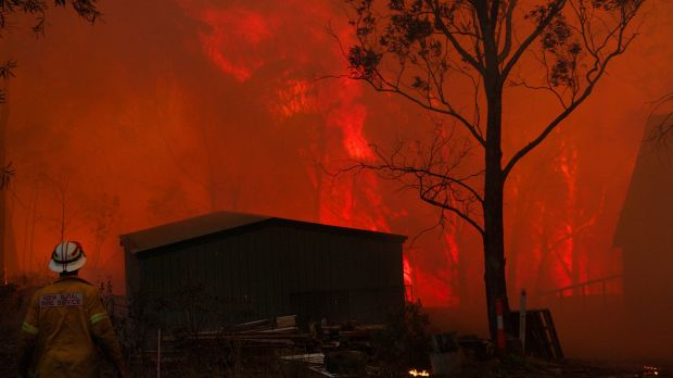 NSW RFS crews struggle to save a home near Dargan on the Bells Line of Road during the Blue Mountains bush fires in 2013.