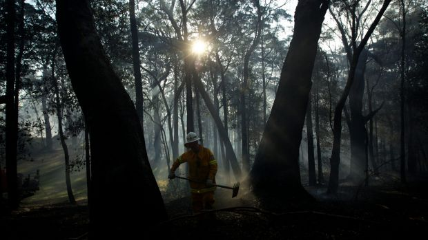 A NSW RFS crew from Kurrajong Brigade works to extinguish a fire that flared around the State Mine fire near Berambing  ...