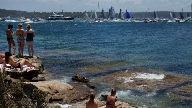 Spectators gather at Watsons Bay to watch the start of the Sydney to Hobart yacht race.