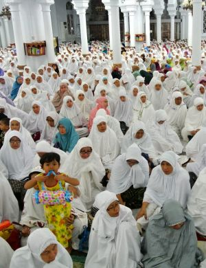 A child among the mourners at Banda Aceh's main mosque.