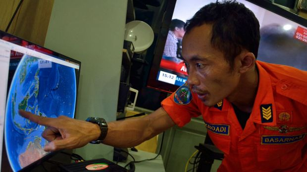 Last contact: An official from Indonesia's national search and rescue agency in Medan, North Sumatra, points to the ...