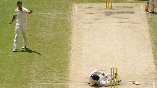 Heating up: India's Virat Kohli falls to the ground after being hit by a throw at the stumps from Australia's Mitchell ...