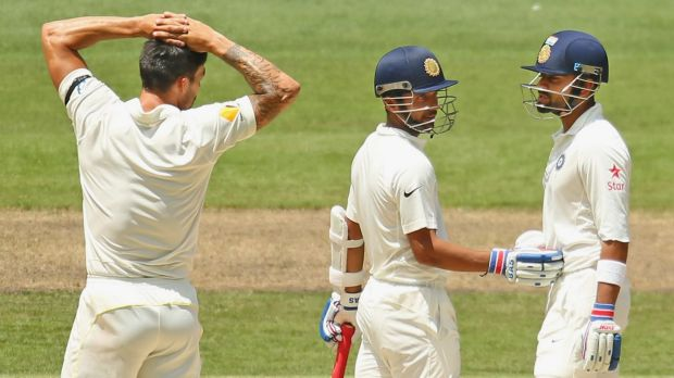 Sweet nothings: Mitchell Johnson and Virat Kohli catch-up.