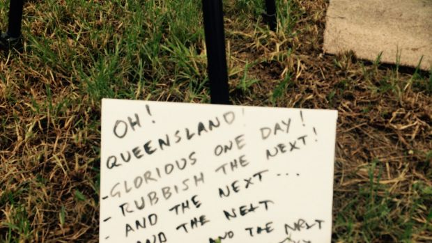 Woodford Folk Festival visitors maintained a sense of humour despite wet weather.