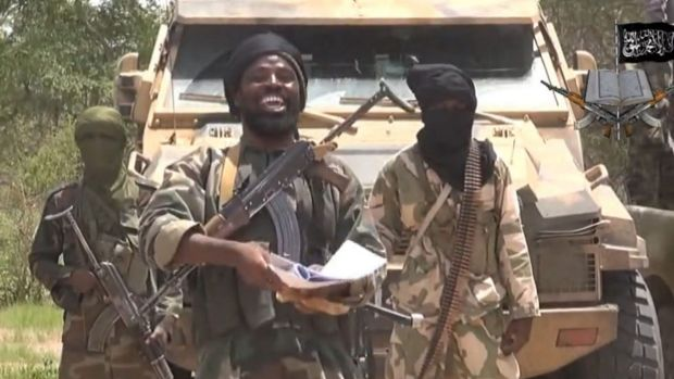 A still from a Boko Haram video shows the leader Abubakar Shekau, centre, who has voiced support for Islamic State militants.