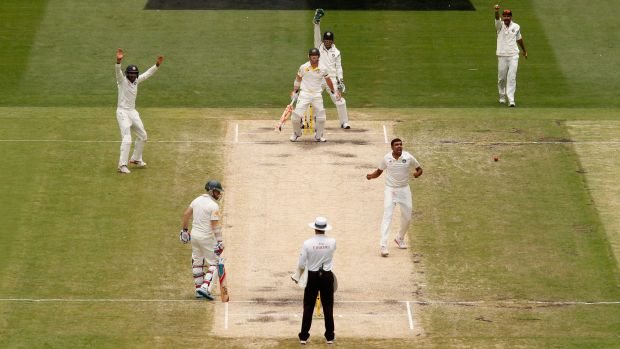 David Warner falls lbw to Ravi Ashwin for 40 as Chris Rogers looks on from the other end.