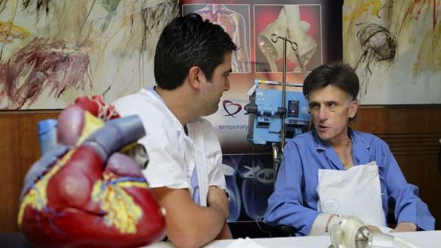 St Vincent s hospital heart surgeon Dr Paul Jansz talks with artifical heart surgery patient Angelo Tigano, 50, the ...