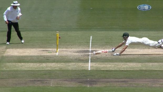 Desperate lunge: Shaun Marsh dives to make his ground.