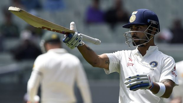 Another milestone: Virat Kohli raises his bat after passing 50.